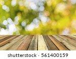 Wood Shelf On Blurred Green...