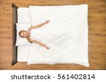 the woman lay on the bed and... | Shutterstock . vector #561402814