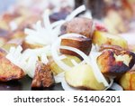 frying potato and onion in...