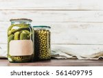 Small photo of Preserved vegetables on wooden background