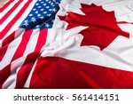 american and canadian flags... | Shutterstock . vector #561414151