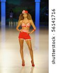 Small photo of CANARY ISLANDS - 26 JUNE: Supermodel Ariadne Artilez on the catwalk wearing bikini from Calima during Moda Calida in Maspalomas June 26,2010 in Canary Islands, Spain