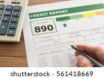 women checking credit score in... | Shutterstock . vector #561418669