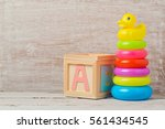 baby toys on wooden table.... | Shutterstock . vector #561434545