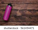 Pink Water Bottle On Brown Woo...