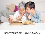 grandmother and grandson are... | Shutterstock . vector #561456229