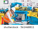 engineer using laptop computer... | Shutterstock . vector #561468811