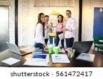 portrait of happy young people... | Shutterstock . vector #561472417