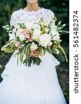 beauty wedding bouquet in bride'... | Shutterstock . vector #561482374
