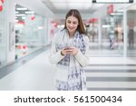 woman using smartphone in the... | Shutterstock . vector #561500434