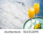 Two Glasses With Mimosa...