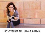 portrait of smiling 40 years... | Shutterstock . vector #561512821