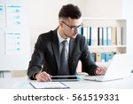 businessman working with... | Shutterstock . vector #561519331