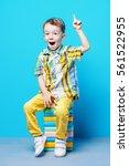 cute little boy in bright... | Shutterstock . vector #561522955