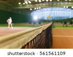 indoor tennis court playing... | Shutterstock . vector #561561109
