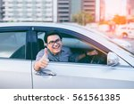 young asian handsome man... | Shutterstock . vector #561561385