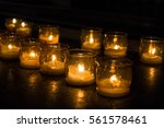 holy candles in a dark ambient | Shutterstock . vector #561578461