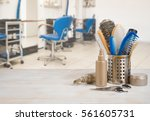 Small photo of Professional hairdresser tools on table over defocused salon interior background.