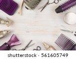 hairdresser tools on wooden... | Shutterstock . vector #561605749