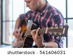 Small photo of Accord chord, Close up of mens hands playing an acoustic guitar