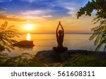 serenity and yoga practicing at ... | Shutterstock . vector #561608311