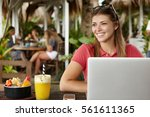 cheerful young caucasian female ...   Shutterstock . vector #561611365