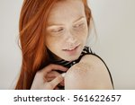Stock photo highly detailed shot of tender and cute teenage female with shy faint smile loose ginger hair and 561622657