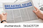 man reading newspaper with the... | Shutterstock . vector #561625729