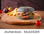 black hamburger with meat cutlet | Shutterstock . vector #561633205