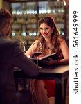 romantic dinner in restaurant | Shutterstock . vector #561649999