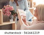 beautiful adult woman is giving ... | Shutterstock . vector #561661219