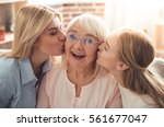 three generations of women.... | Shutterstock . vector #561677047