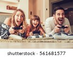 playful family playing video... | Shutterstock . vector #561681577