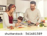 happy young family preparing... | Shutterstock . vector #561681589