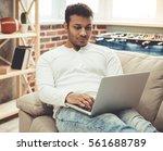 attractive afro american man is ... | Shutterstock . vector #561688789