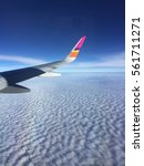 sky view from the plane | Shutterstock . vector #561711271
