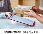 delivery man delivering parcel... | Shutterstock . vector #561712141