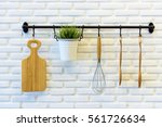 kitchen tools hang on the white ... | Shutterstock . vector #561726634