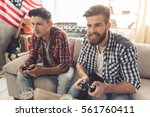attractive guys are playing...   Shutterstock . vector #561760411
