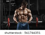 muscular man working out in gym ... | Shutterstock . vector #561766351