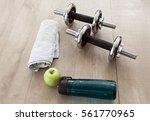 fitness set on the wooden floor | Shutterstock . vector #561770965