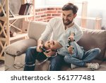 cute little girl and her... | Shutterstock . vector #561777481