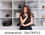 beautiful young woman standing... | Shutterstock . vector #561790711