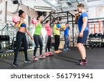 men and women with coach at... | Shutterstock . vector #561791941