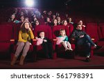 happy family in the movie | Shutterstock . vector #561798391