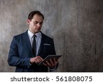 portrait of a businessman with... | Shutterstock . vector #561808075