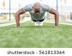 fitness black man exercising... | Shutterstock . vector #561813364