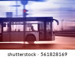 bus moving on the road in city... | Shutterstock . vector #561828169