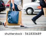 feet of pedestrians walking on... | Shutterstock . vector #561830689