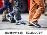 feet of pedestrians walking on... | Shutterstock . vector #561830719